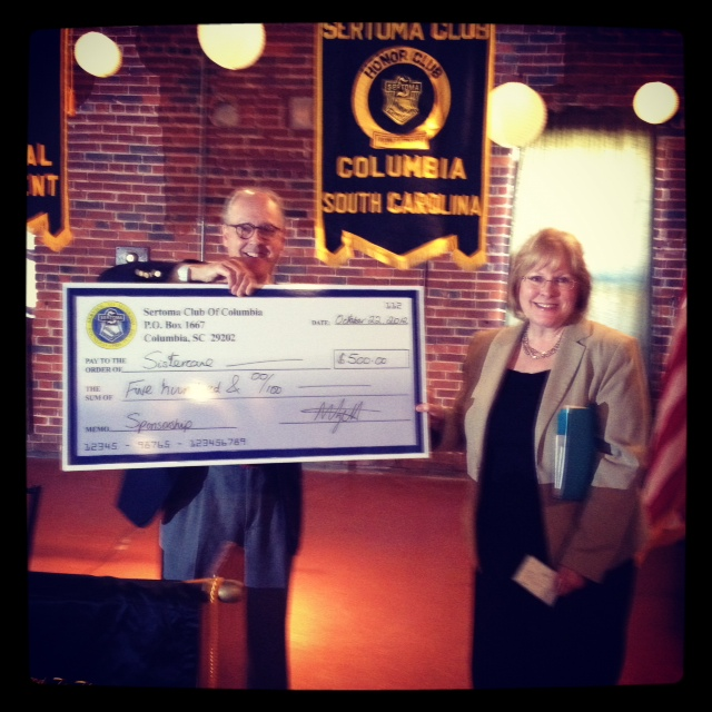 Joe Hodson of Sertoma presents Sistercare with a 4500 check